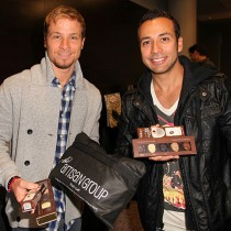 <h4>Brian Littrell & Howie Dorough</h4>Brian Littrell & Howie Dorough, from the Backstreet Boys show off their Hot Chocolate Spoon and Faces of the World chocolates.