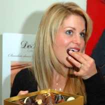 <h4>Candace Cameron</h4>Candace Cameron, from Full House, enjoys a truffle from the Truffle Collection.