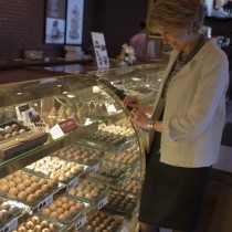 <h4>Jane Pauley</h4>Jane Pauley admiring the chocolate cases while visiting the DeBrand Corporate Headquarters.