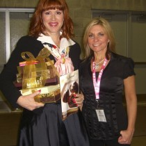 <h4>Molly Ringwald & Cathy Brand-Beere</h4>Molly Ringwald and Cathy Brand-Beere with a tower of DeBrand chocolates at the 2012 IPFW Tapestry event.
