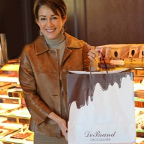 <h4>Patricia Heaton</h4>Patricia Heaton with a bag full of DeBrand chocolates at DeBrand Corporate Headquarters.