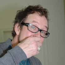 <h4>Scott Shriner</h4>Scott Shriner from Weezer tasting DeBrand chocolates.