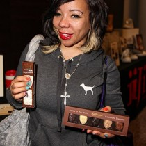 "<h4>Tameka ""Tiny"" Cottle</h4>Tameka ""Tiny"" Cottle, from The Family Hustle, poses with DeBrand's Hot Chocolate on a Spoon and Faces of the World."